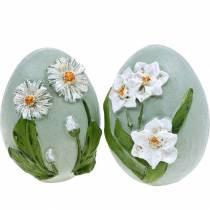 Påskägg med blommotiv tusenskönor och påskliljor blå, grön gips diverse 2st